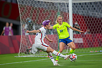 TOKYO, JAPAN - JULY 21: Megan Rapinoe #15 of the United States wide passes the ball during a game between Sweden and USWNT at Tokyo Stadium on July 21, 2021 in Tokyo, Japan.
