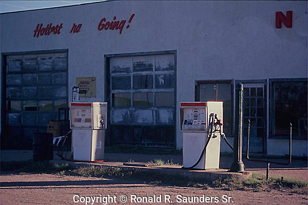OLD GAS PUMPS IN FRONT OF RURAL GAS STATION