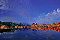 749450421 early morning lights up mount moran the tetons and the fall colored yellow aspen along the snake river at oxbow bend in grand tetons national park wyoming united states
