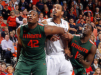 CHARLOTTESVILLE, VA- JANUARY 7: Reggie Johnson #42 of the Miami Hurricanes looks for the rebound next to Mike Scott #23 of the Virginia Cavaliers and Durand Scott #1 of the Miami Hurricanes during the game on January 7, 2012 at the John Paul Jones Arena in Charlottesville, Virginia. Virginia defeated Miami 52-51. (Photo by Andrew Shurtleff/Getty Images) *** Local Caption *** Mike Scott;Reggie Johnson;Durand Scott