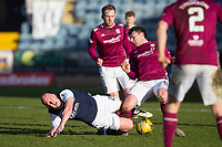 13th March 2021; Dens Park, Dundee, Scotland; Scottish Championship Football, Dundee FC versus Arbroath; Charlie Adam of Dundee is tackled by Michael McKenna of Arbroath