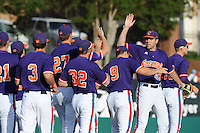 Clemson Tigers celebrate at the conclusion of  a  game against the Miami Hurricanes at Doug Kingsmore Stadium on March 31, 2012 in Clemson, South Carolina. The Tigers won the game 3-1. (Tony Farlow/Four Seam Images).