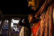 Truck driver and his assistants wait for their turn inside the truck at the Goladi Depot in Jharia, Jharkhand, India.