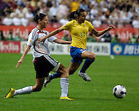 Brazilian forward Marta (10) slips away from a tackle by Germany's Linda Bresonik. Germany (GER) defeated Brazil (BRA) 2-0 in the finals of the 2007 FIFA Women's World Cup. at Shanghai Hongkou Football Stadium in Shanghai, China on September 30, 2007.