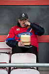 Dagenham and Redbridge 1 Burton Albion 3, 21/02/2015. Victoria Road, League Two. A Dagenham supporter enjoys a pre match snack. Burton Albion moved to the top of League Two following a hard-fought win over Dagenham & Redbridge played in-front of 1,718 supporters. Photo by Simon Gill.