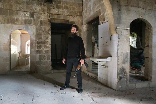 """Shooting of the Syrian series """"Muzakarat Aseka Sabeka"""" (""""Memories of a former lover"""") Lebanon Mars 2017 (Mars Media Production). Salah is the clapman of the crew: in this scene he is an improvised extra and plays the bodyguard of a mafia leader in his underground HQ. With his hipster beard, he was had the perfect look to play a salafist on the screen.<br /> <br /> Tournage de la série Syrienne """"Muzakarat Aseka Sabeka"""" (""""Mémoires d'une amante révolue"""") Liban, Mars 2017 (Mars Media Production). Salah est le clapman dans l'équipe de tournage: dans cette scène il est improvisé figurant pour faire le rôle d'un garde du corps, dans le QG d'un mafieux Syrien: avec sa barbe de hipster, il passait facilement pour un salafiste à l'écran."""