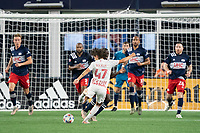 FOXBOROUGH, MA - MAY 22: John Tolkin #47 of New York Red Bulls takes a shot at goal during a game between New York Red Bulls and New England Revolution at Gillette Stadium on May 22, 2021 in Foxborough, Massachusetts.
