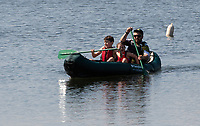 Ardingly, ENGLAND. 25.05.2020<br /> .<br /> A family canoeing enjoy the sun during the bank holiday Monday Covid-19 lockdown with government guidelines to social distance  at Ardingly Reservoir, Ardingly, West Sussex, England at  on 25 May 2020. Photo by Alan Stanford.