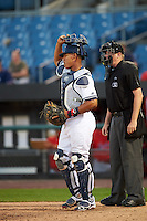 Syracuse Chiefs catcher Pedro Severino (4) and umpire Chad Whitson during a game against the Louisville Bats on June 6, 2016 at NBT Bank Stadium in Syracuse, New York.  Syracuse defeated Louisville 3-1.  (Mike Janes/Four Seam Images)