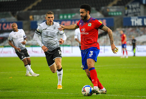31st October 2020; Liberty Stadium, Swansea, Glamorgan, Wales; English Football League Championship Football, Swansea City versus Blackburn Rovers; Derrick Williams of Blackburn Rovers looks to pass while under pressure form Viktor Gyokeres of Swansea City