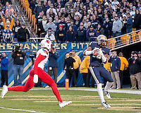 Pitt wide receiver Dontez Ford makes a 32-yard touchdown catch as Louisiville Cardinal defensive back Josh Harvey-Clemons chases. The Pitt Panthers football team defeated the Louisville Cardinals 45-34 on Saturday, November 21, 2015 at Heinz Field, Pittsburgh, Pennsylvania.