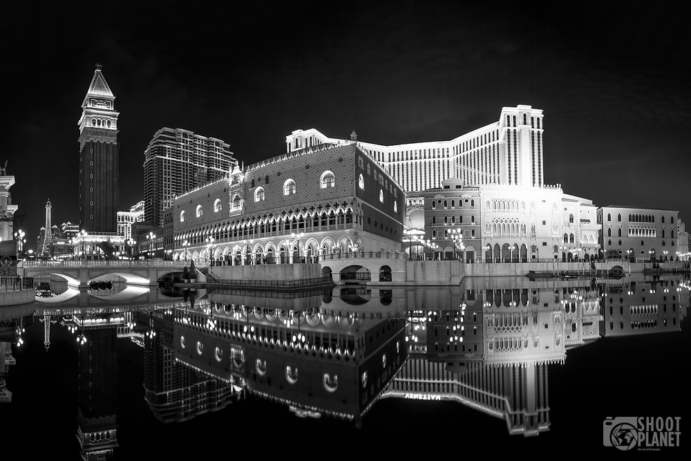 Black-and-white night panorama of the beautiful Venetian Macao Resort Hotel, replica of Las Vegas, with amazing water reflection, Macao China