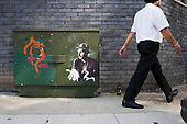 Street art on a telephone junction box in Hackney Wick, east London, an ex-industrial district adjacent to the Olympic Park which has become home to young artists, musicians and a variety of small businesses.