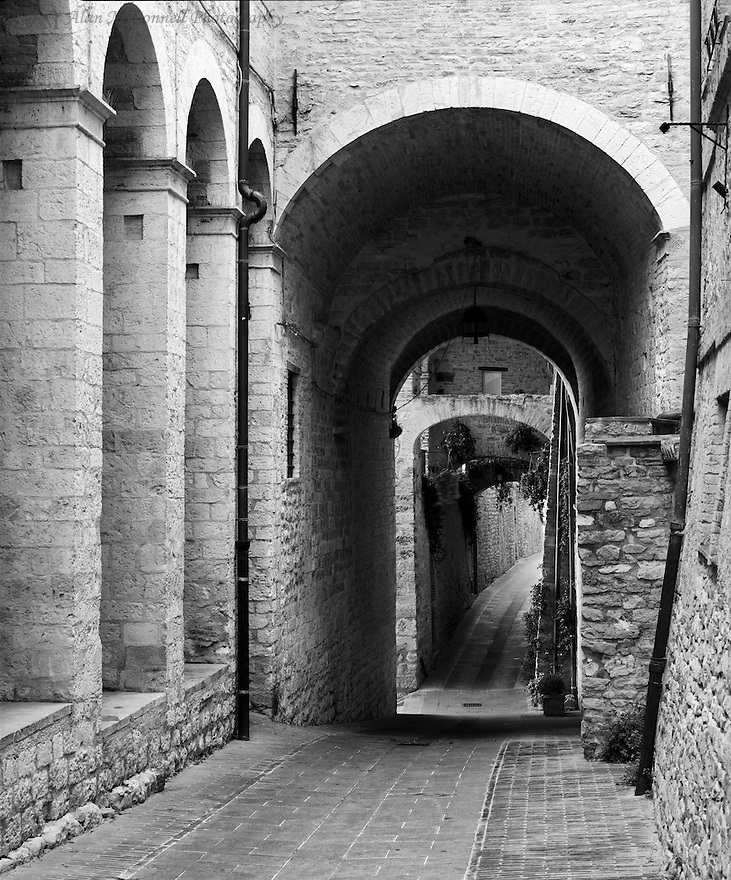 """""""Assisi Alley""""<br /> Assisi, Italy<br /> 2015<br /> <br /> Cobblestone Streets and arches are distinct features along the passageways in Assisi.<br /> <br /> 4 x 5 Large Format Film"""