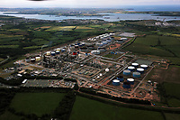Pictured: Aerial view of the Murco oil refinery near Milford Haven, Pembrokeshire, west Wales. Monday 06 June 2011.<br /> Re: The four people killed in the explosion and fire at the Chevron oil refinery in Pembrokeshire have been named.<br /> They were Julie Jones, 54, a fire guard from Pembroke, and three men from Milford Haven: Dennis Riley, 52, Robert Broome, 48, and Andrew Jenkins, 33.<br /> Ms Jones was a mother of one and grandmother, Mr Riley a father of two and grandfather, Mr Broome a father of seven and Mr Jenkins had young twins.<br /> A fifth person is critical but stable after Thursday's blast at Pembroke.<br /> Churches are opening their doors to allow people to say prayers for the victims, with books of condolence available and priests offering support.<br /> <br />  <br /> It could be some time before the cause of the explosion is known Dyfed-Powys Police said the bodies were removed from the scene on Friday night.
