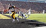 Iowa's Adam Robinson scores a touchdown on a second quarter reception in front of a Michigan State linebacker Greg Jones.  Iowa versus Michigan State in an NCAA football game Saturday, October 30, 2010 in Iowa City.