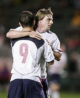 Chad Barrett, left, Eddie Gaven, right, USA over Trinidad, 6-1, Wednesday, Jan. 12, 2005, in Carson, California.