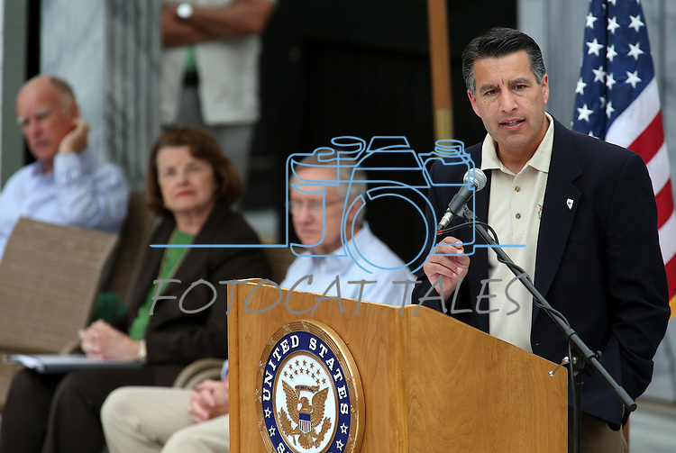 Nevada Gov. Brian Sandoval speaks at the 17th annual Lake Tahoe Summit conference at Sand Harbor, near Incline Village, Nev., on Monday, Aug. 19, 2013. From left rear are California Gov. Jerry Brown, U.S. Sen. Dianne Feinstein, D-Calif., and Senate Majority Leader Harry Reid, D-Nev.<br /> Photo by Cathleen Allison