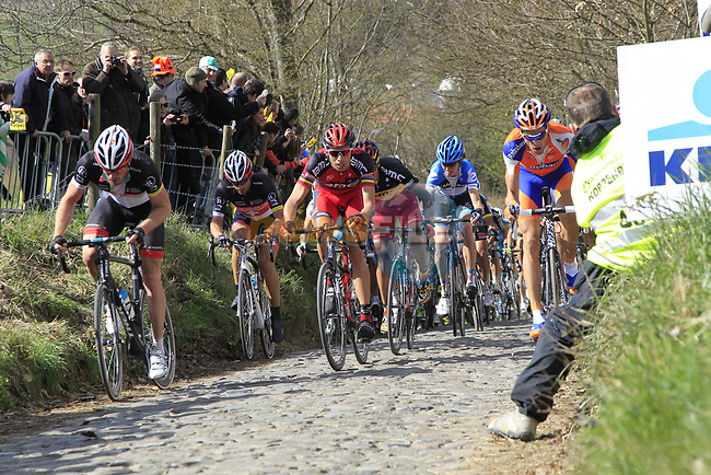 The peloton led by Maarten Wynants (BEL) Rabonbank, Alessandro Ballan (ITA) and Philippe Gilbert (BEL) BMC Racing Team and Fabian Cancellara (SUI) Radioshack-Nissan climb Koppenberg during the 96th edition of The Tour of Flanders 2012, running 256.9km from Bruges to Oudenaarde, Belgium. 1st April 2012. <br /> (Photo by Eoin Clarke/NEWSFILE).