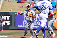 Luis Mateo #3 of the Memphis Redbirds throws to first base to complete a double play against the Omaha Storm Chasers at Werner Park on April 9, 2014 in Omaha, Nebraska. The Storm Chasers beat the Redbirds 20-3.   (Dennis Hubbard/Four Seam Images)