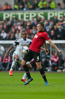 Saturday 17 August 2013<br /> <br /> Pictured: Wayne Routledge of Swansea and Phil Jones of Manchester United<br /> Re: Barclays Premier League Swansea City v Manchester United at the Liberty Stadium, Swansea, Wales