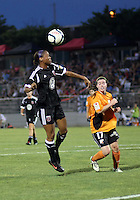 BOYDS, MARYLAND-JULY 07,2012:  Maddy Brown (4) of DC United Women heads over Brittany Charles (17) of Dayton Dutch Lions during a W League game at Maryland Soccerplex, in Boyds, Maryland. DC United women won 4-1.