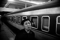 Passengers wait for a train to leave in Haerbin, Heilongjiang, China.
