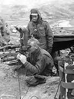 """Maj. Gen. Frank Lowe, USA, presidential representative in Korea, examines """"flash range"""" instruments on the Marine front lines.  Explaining the instrument is Marine S.Sgt. Charles Kitching of Redlands, Calif.  March 1951.  T. Sgt. Vance Jobe.  (Marine Corps)<br /> Exact Date Shot Unknown<br /> NARA FILE #:  127-N-A131033<br /> WAR & CONFLICT BOOK #:  1409"""