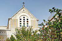 Dormition of the Virgin Mary Church decorated with the famous geometric scratch patterns in the medieval mastic village of Pyrgi on the island of Chios, Greece