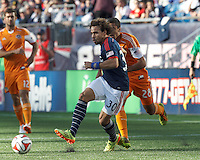 New England Revolution defender Kevin Alston (30) passes the ball.  In a Major League Soccer (MLS) match, the New England Revolution (blue/white) defeated Houston Dynamo (orange), 2-0, at Gillette Stadium on April 12, 2014.