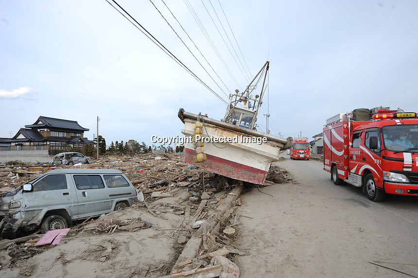 A boat lies in the road 2 km from the coastline in the town of  Natori, after the Tsunami devastated the entire pacifc coastline of Japan after the earthquake and tsunami devastated the area Sendai, Japan.<br />