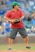Actor Jim Belushi throws the first pitch to second base before a game between the Miami Marlins and the Chicago Cubs at Wrigley Field on July 17, 2012 in Chicago, Illinois. The Marlins defeated the Cubs 9-5. (Tony Farlow/Four Seam Images).