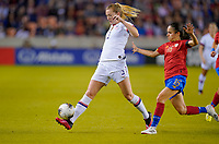 HOUSTON, TX - FEBRUARY 03: Samantha Mewis #3 of the United States passes off a ball past Katherine Alvarado #16 of Costa Rica during a game between Costa Rica and USWNT at BBVA Stadium on February 03, 2020 in Houston, Texas.