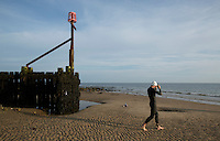 27 JUL 2013 - CROMER, GBR - A competitor walks to the water to warmup ahead of the start of The Anglian Triathlon 2013 at West Runton, North Norfolk, Great Britain (PHOTO COPYRIGHT © 2013 NIGEL FARROW, ALL RIGHTS RESERVED)