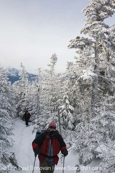 Hiking on North Carter Trail in the White Mountains, New Hampshire during the winter months.