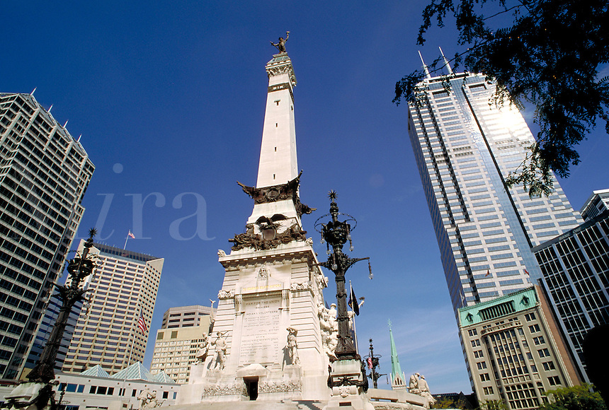 The Soldiers and Sailors Monument and surrounding skyscrapers at Monument Circle in downtown Indianapolis, Indiana. Indianapolis Indiana.