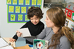 Education preschool 3-4 year olds SEIT working with 3 year old boy in classroom