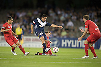 MELBOURNE, AUSTRALIA - OCTOBER 30: Carlos Hernandez of the Victory shoots for goal during the round 12 A-League match between the Melbourne Victory and Adelaide United at Etihad Stadium on October 30, 2010 in Melbourne, Australia.  (Photo by Sydney Low / Asterisk Images)