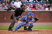 Umpire Edwin Moscoso and Lexington Legends catcher Chase Vallot (15) during a game against the Hagerstown Suns on May 22, 2015 at Whitaker Bank Ballpark in Lexington, Kentucky.  Lexington defeated Hagerstown 5-1.  (Mike Janes/Four Seam Images)