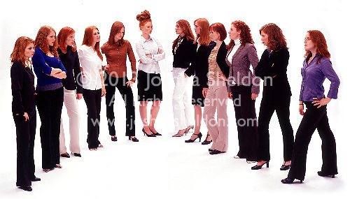 Group of red haired women facing each other