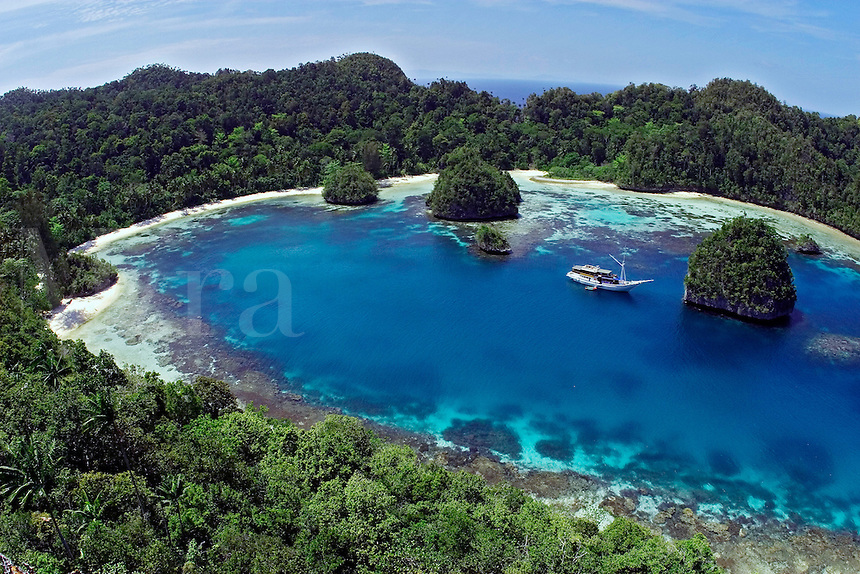 A live-aboard dive vessel at anchor in the Raja Ampat Islands, Indonesia.<br />