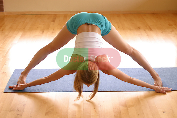 young woman working out and getting in shape with weights and yoga