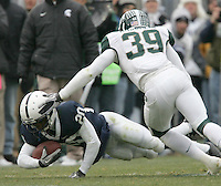 State College, PA - 11/27/2010:  WR Devon Smith (20) dives for extra yards while being tackled by MSU safety Trenton Robinson.  Penn State lost to Michigan State by a score of 28-22 on Senior Day at Beaver Stadium...Photo:  Joe Rokita / JoeRokita.com..Photo ©2010 Joe Rokita Photography