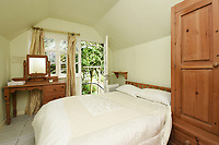 BNPS.co.uk (01202 558833)<br /> Pic:  Riverhomes/BNPS<br /> <br /> Pictured: A bedroom with access to the garden.<br /> <br /> A striking Victorian boathouse that has been used as a film set is on the market for £2m.<br /> <br /> The time capsule building by the River Thames was used in a film version of The Wind in the Willows and the 1996 film True Blue, about the Oxford Cambridge boat race.<br /> <br /> It has an enclosed mooring as well as two moorings on the bank, perfect for those who want to spend their days messing about in boats like Ratty and Mole.