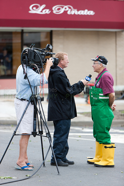 MAMARONECK, NY - AUGUST 28: Mayor Norman Rosenblum of the Village of Mamaroneck, New York is interviewed by a news crew from NY CBS channel 2 on Sunday August 28, 2011 in the aftermath of Hurricane Irene.