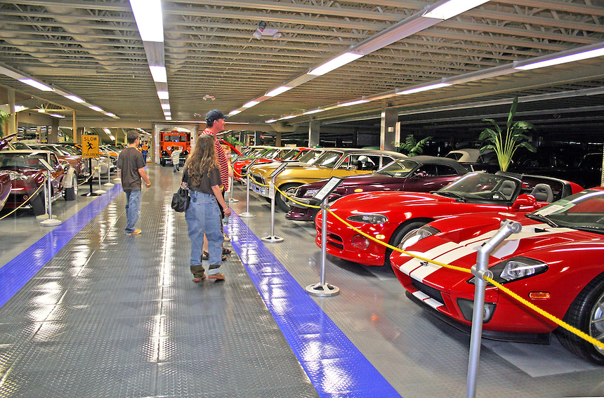 People viewing vintage cars in Tallahassee Automobile Museum Florida