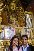 Nepal, Kathmandu, Swayambhunath.  Newly-Married Couple Visiting a Buddhist Shrine.