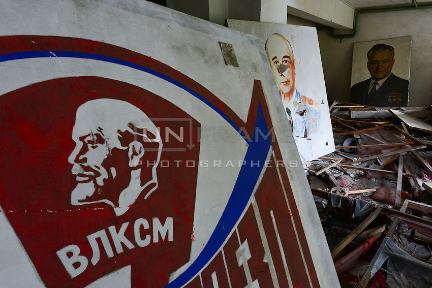 Portraits of old leaders inside the remains of old cultural center in Pryptat
