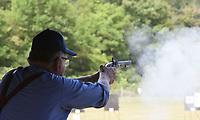 Roy Brown of Yakima, Wash., shoots his black-powder pistol on Sept. 24 2021 at the Saunders Memorial Shoot.<br />(NWA Democrat-Gazette/Flip Putthoff)