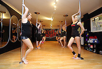 Pictured: Pole dancers during their world record attempt. Saturday 22 February 2014<br /> Re: Eight women have attempted to set a new world record of most people pole dancing at the same time.<br /> Pole 4 Life world record attempt was organised by Lisa Broughton at her Pole Twisters dance studio in Cardiff.<br /> The women had to pole dance for six minutes to set the new record.